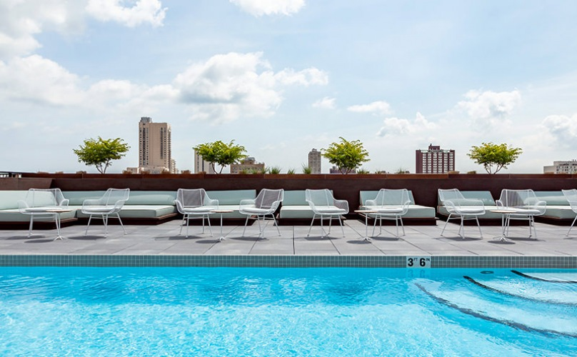 Sparkling rooftop pool with city view